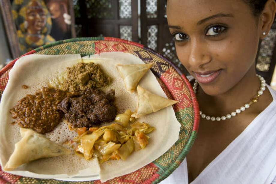 "Lillie Hunegan shows a variety of Ethiopian foods from the Blue Nile Ethiopian Restaurant, 9400 Richmond Ave.""It doesn't really matter whether you go with lamb, beef, chicken, fish or vegetarian choices from the menu as the meals revolve around the interesting Ethiopian bread called injera. It isn' like anything I have ever had."" John Hook Photo: Brett Coomer, Chronicle"
