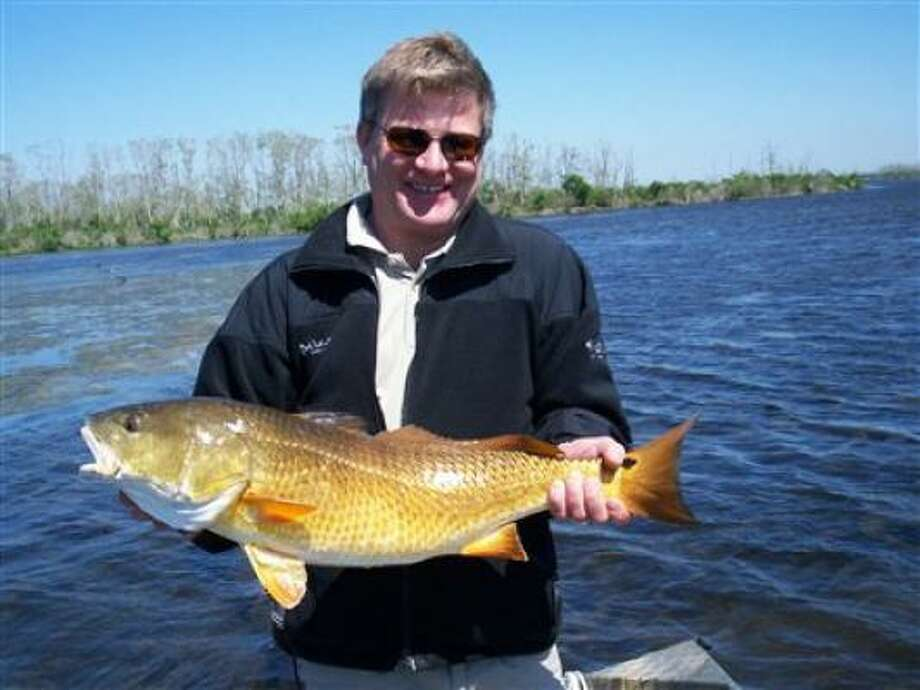 Rocky Elgert of Alberta Canada displays a large redfish.