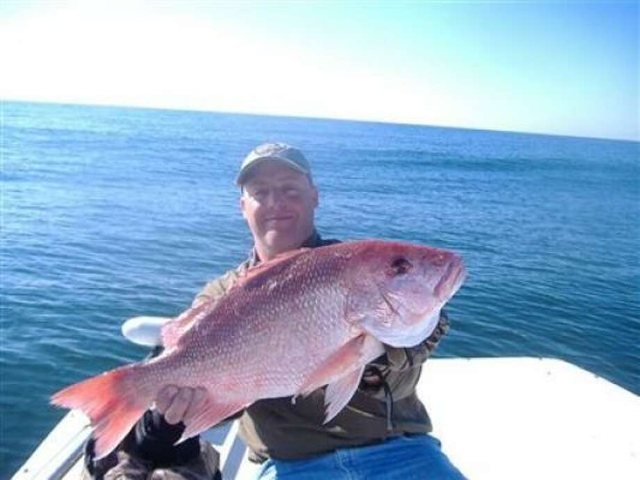Kyle Bradley displays a 26-inch red snapper.
