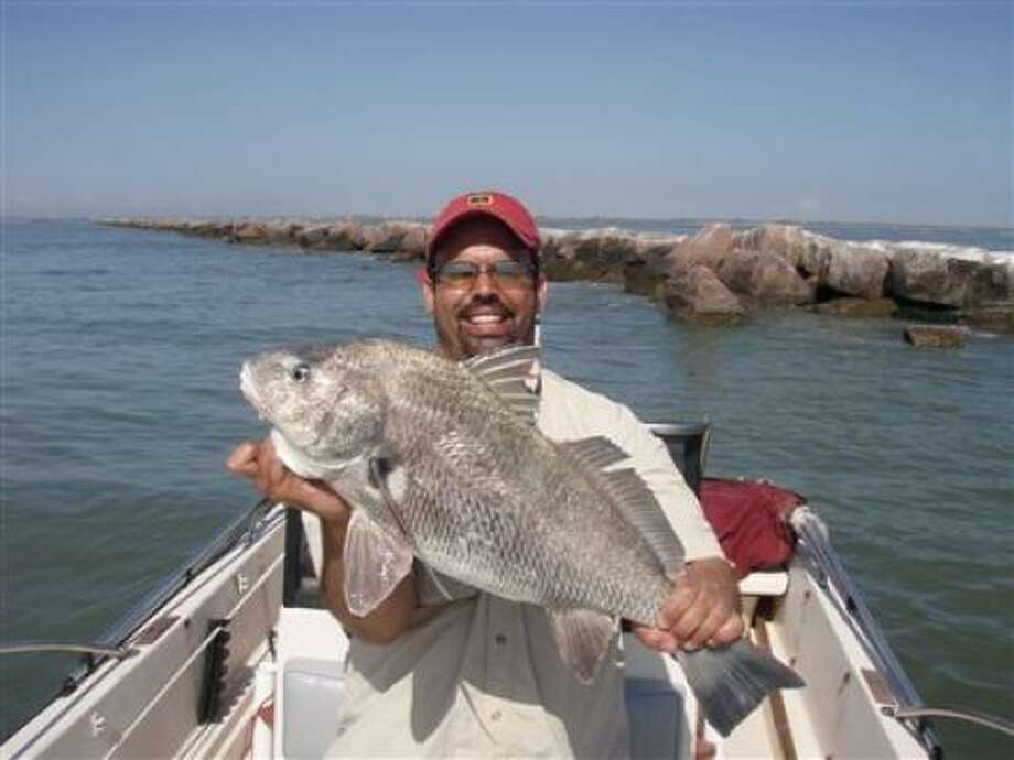 Ronnie Miranda of Houston shows off a rather large black drum.