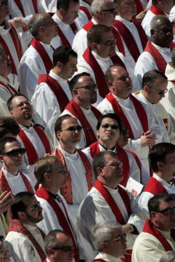 Catholic clergy stand as Pope Benedict XVI conducts mass at Nationals Park in Washington, D.C., on T