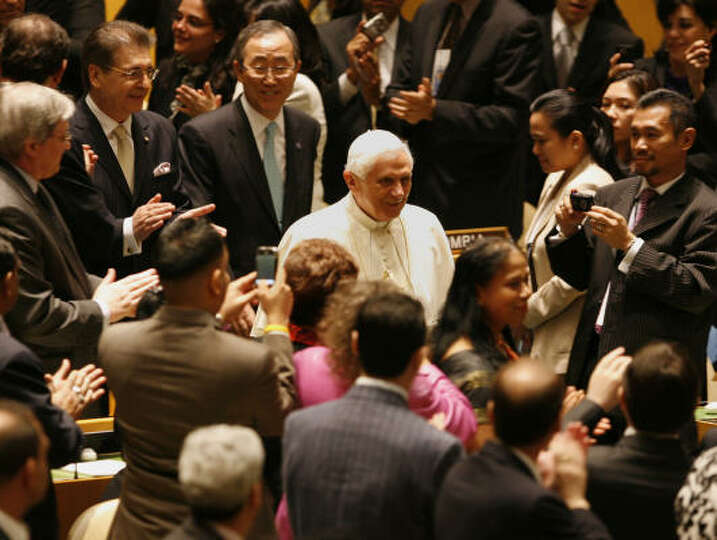 Pope Benedict XVl, followed by Secretary General Ban Ki-moon, enters the General Assembly at the Uni