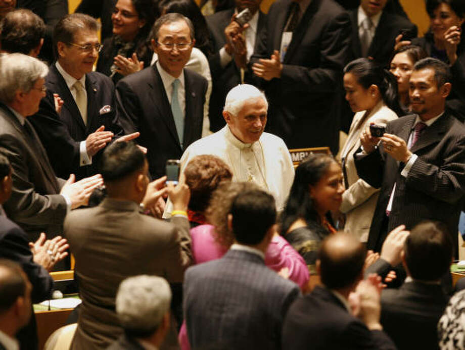 Pope Benedict XVl, followed by Secretary General Ban Ki-moon, enters the General Assembly at the United Nations headquarters on Friday. Photo: Peter Morgan, AP