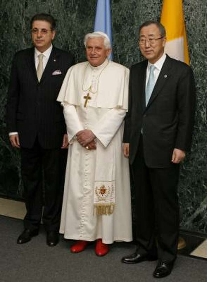 Pope Benedict XVI poses with General Assembly President Srgjan Kerim, left, of Macedonia, and U.N. Secretary-General Ban Ki-moon as the pontiff arrives at United Nations headquarters on Friday. Photo: Jason DeCrow, AP