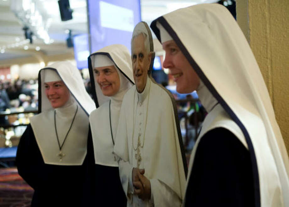 Nuns pose on Friday with a life size cutout of Pope Benedict XVI before the National Catholic Prayer Breakfast at the Washington Hilton Hotel in Washington, DC.  Republican presidential candidate Sen. John McCain (R-AZ) attended the annual event where U.S. President George W. Bush spoke to the group. Photo: Brendan Smialowski, Getty Images