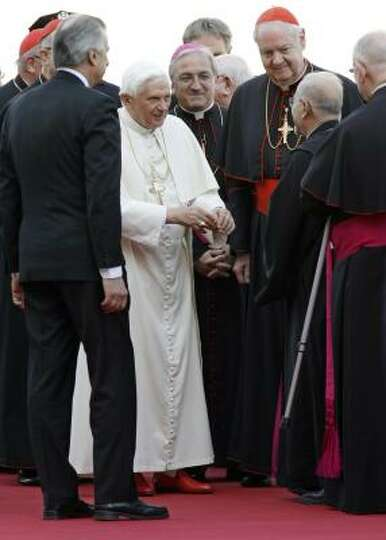 Pope Benedict XVI is greeted by members of the Catholic clergy, including Cardinal Edward Egan, arch