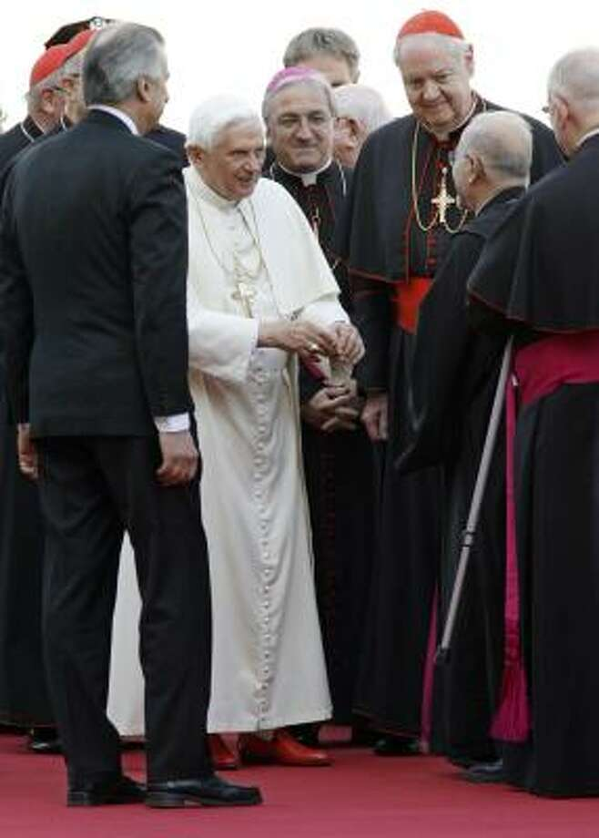 Pope Benedict XVI is greeted by members of the Catholic clergy, including Cardinal Edward Egan, archbishop of New York, third from right, as he arrives at John F. Kennedy International Airport in New York on Friday. The other clergy members are unidentified. Photo: Stuart Ramson, AP