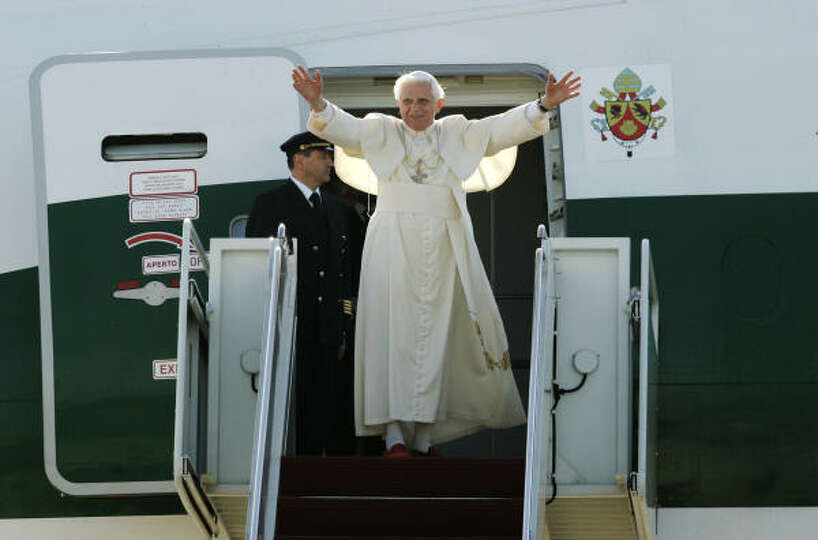 Pope Benedict XVI on Friday waves prior to boarding an airplane at Andrews Air Force Base in Marylan