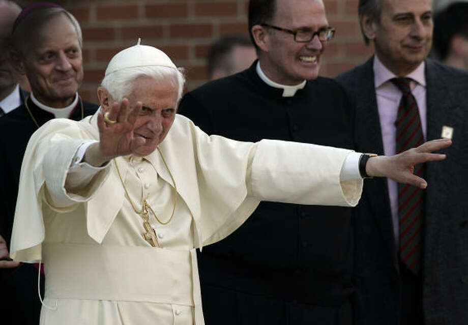 Pope Benedict XVI waves to the crowd as he leaves the Edward J. Pryzbyla University Center at Catholic University in Washington, D.C., on Thursday where delivered a speech on Catholic education to the heads of the more than 200 US Catholic colleges and universities and superintendents of the 195 dioceses. Photo: NICHOLAS KAMM, AFP/Getty Images