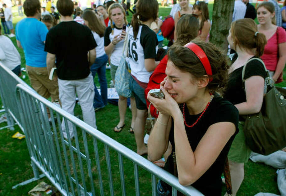 Student Laura Namestka of Pittsburgh cries onThursday as she tells her father by cell phone that she saw Pope Benedict XVI as he departed the Edward J. Pryzbyla University Center Building at Catholic University in Washington D.C. Photo: Mark Wilson, Getty Images