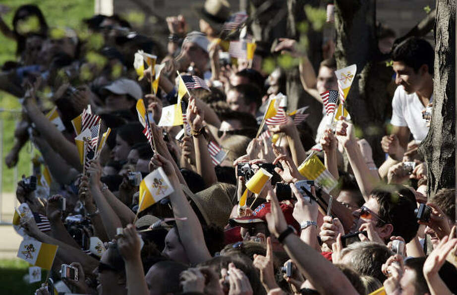 People cheer as Pope Benedict XVI arrives at the Edward J. Pryzbyla University Center at Catholic Un