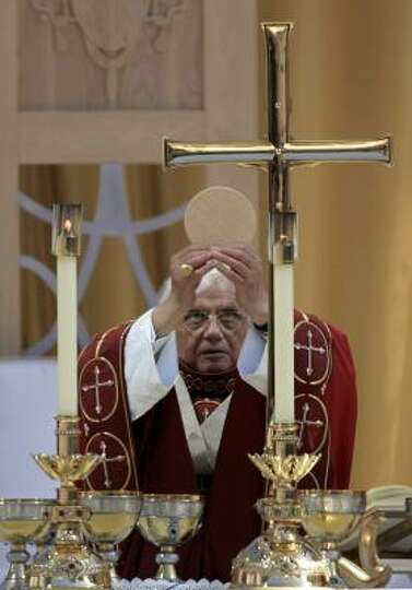 Pope Benedict XVI consecrates the host during a Mass on Thursday at Washington Nationals baseball Pa