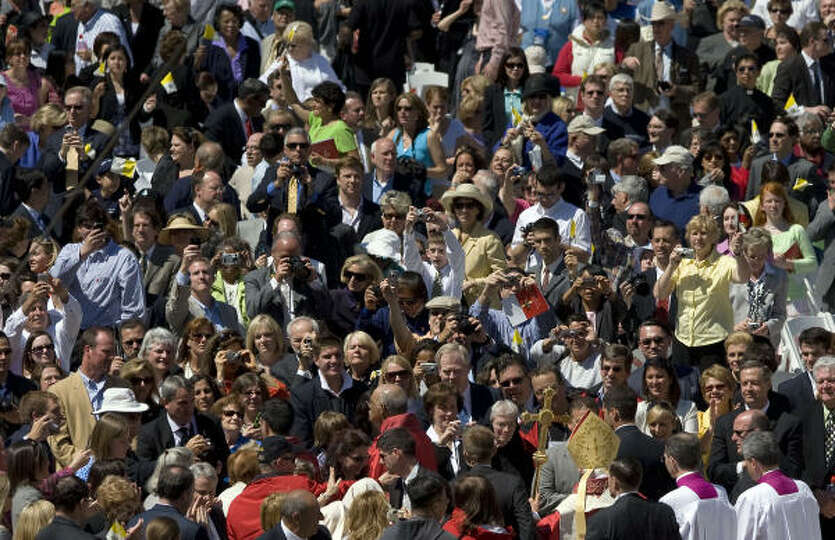 Thousands of people watch as Pope Benedict XVI (lower R) departs Nationals Park in Washington, D.C.,