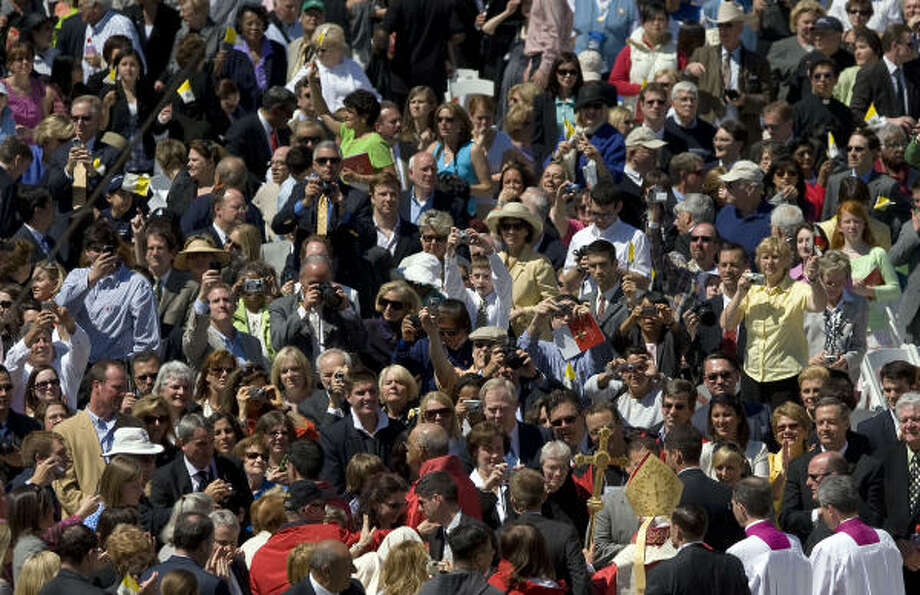 """Thousands of people watch as Pope Benedict XVI (lower R) departs Nationals Park in Washington, D.C., after a papal Mass. Pope Benedict XVI urged US Catholics to renew their faith and condemned the """"tragic"""" sexual abuse of children by priests as he celebrated Mass before tens of thousands at a baseball stadium. Photo: JIM WATSON, AFP/Getty Images"""