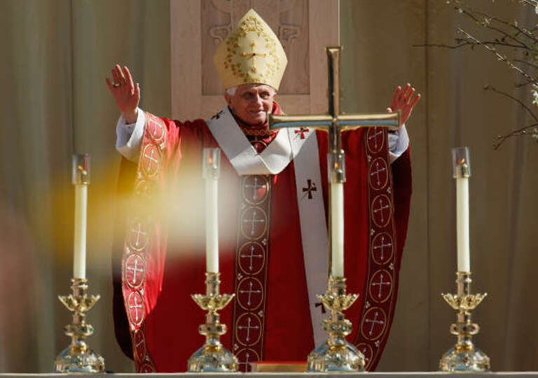 Pope Benedict XVI raises his arms on Thursday as he celebrates Mass at Nationals Park in Washington,