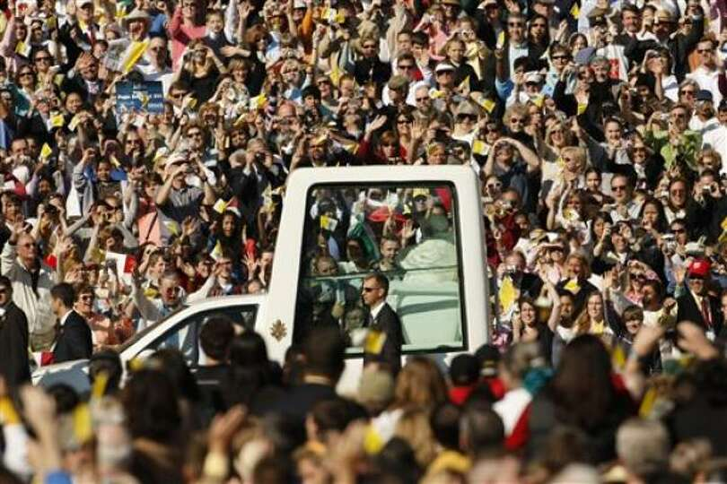 The Popemobile, with Pope Benedict XVI aboard, makes his entrance for a Mass on Thursday at Washingt