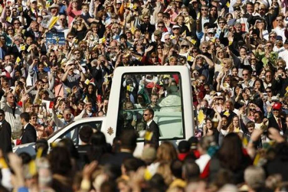 The Popemobile, with Pope Benedict XVI aboard, makes his entrance for a Mass on Thursday at Washington Nationals baseball Park in Washington, D.C. Photo: Pablo Martinez Monsivais, AP