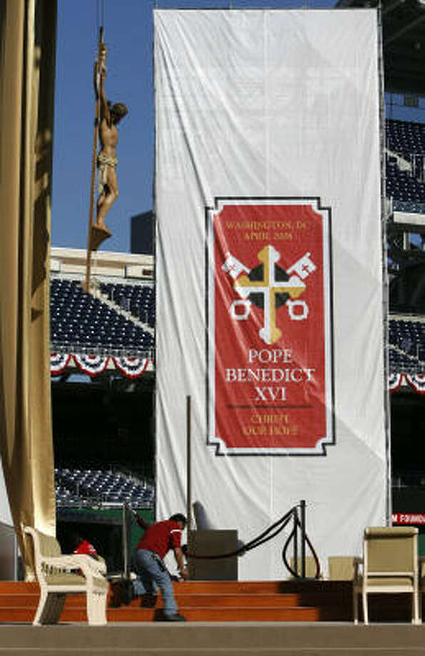 Workers put the final touches on Nationals Park in Washington to prepare the ballpark for Thursday morning's Papal Mass of Pope Benedict XVI. Photo: Jacquelyn Martin, AP