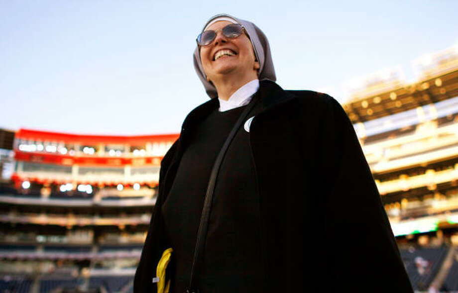 A nun watches the opening services before Pope Benedict XVI celebrates Mass on Thursday at Nationals Park in Washington, DC. Today is Pope Benedict XVI's third day of his visit to the United States. Photo: Win McNamee, Getty Images