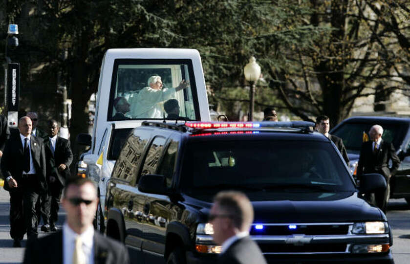 Pope Benedict XVI waves as he arrives at the Basilica of the National Shrine of the Immaculate Conce