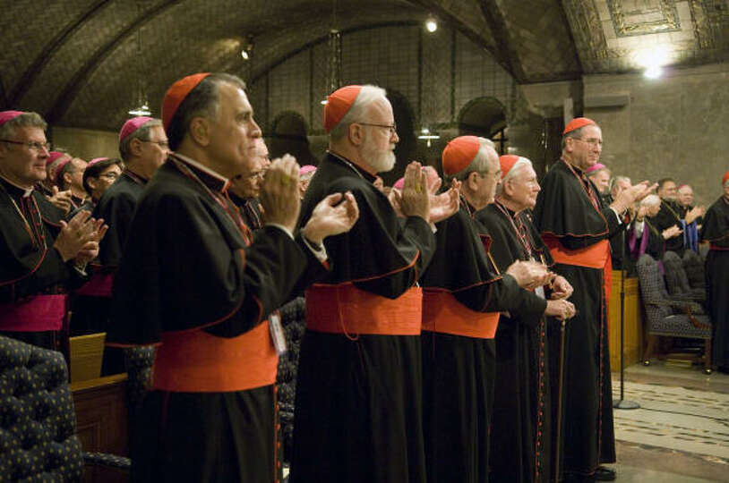Houston's Cardinal Daniel N. DiNardo, left, joins other cardinals in the front row during a prayer s