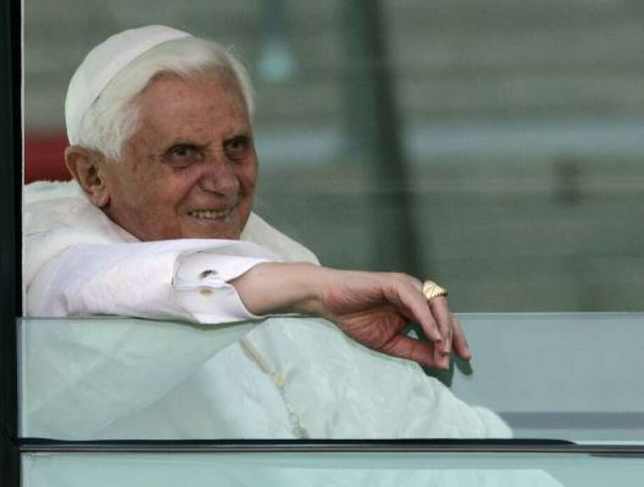 Pope Benedict XVI smiles as he arrives at the Basilica of the National Shrine of the Immaculate Conception. Photo: Haraz N. Ghanbari, AP