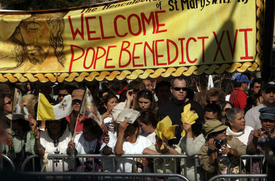 Faithful from around the world gather in front of the Basilica of the National Shrine in Washington, D.C., hoping to get a glimpse of Pope Benedict when he drives by in his Popemobile on Wednesday afternoon. Photo: Laurence Kesterson, MCT