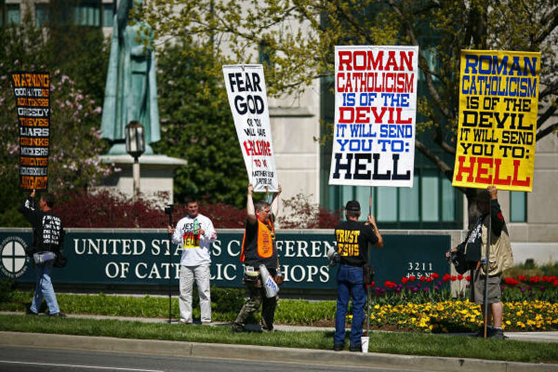 Protesters denounce the Catholic Church in front of the United States Conference of Catholic Bishops