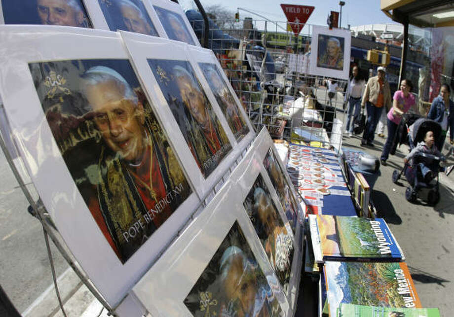Photos of Pope Benedict XVI are displayed for sale on a street corner near Yankee Stadium in the Bronx, New York, on Wednesday. The pope will give Mass at Yankee Stadium on Sunday. Photo: Julie Jacobson, AP