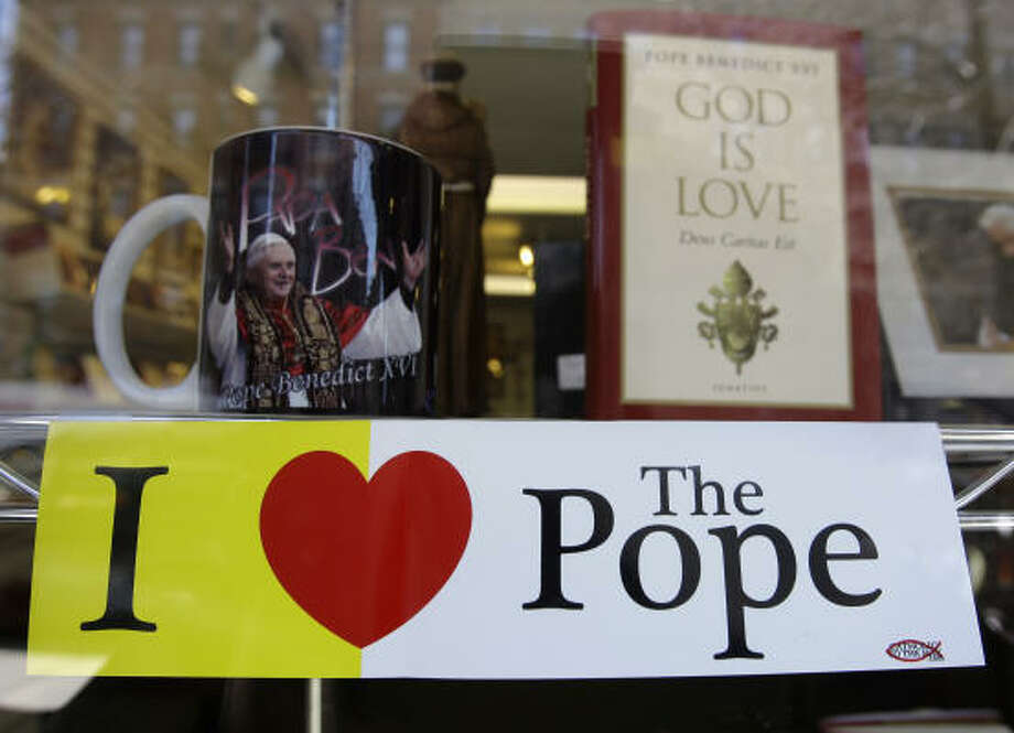 Memorabilia for Pope Benedict XVI is displayed on Wednesday in a Catholic bookstore window in the Bronx borough of New York. The pontiff will give Mass at Yankee Stadium on Sunday. Photo: Julie Jacobson, AP