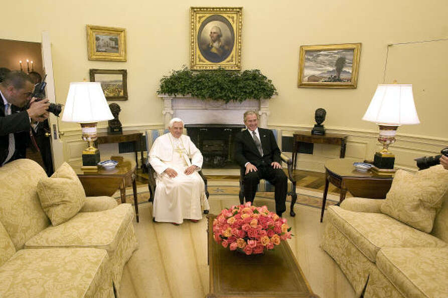 Pope Benedict XVI and U.S. President George W. Bush sit in the Oval Office following a welcome cerem
