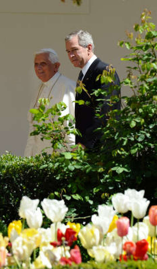 US President George W. Bush and Pope Benedict XVI walk through the colonnade on their way to the Oval at the White House on Wednesday. Benedict XVI became just the second pope to visit the White House and the first to come here in nearly three decades. Photo: VINCENZO PINTO, AFP/Getty Images