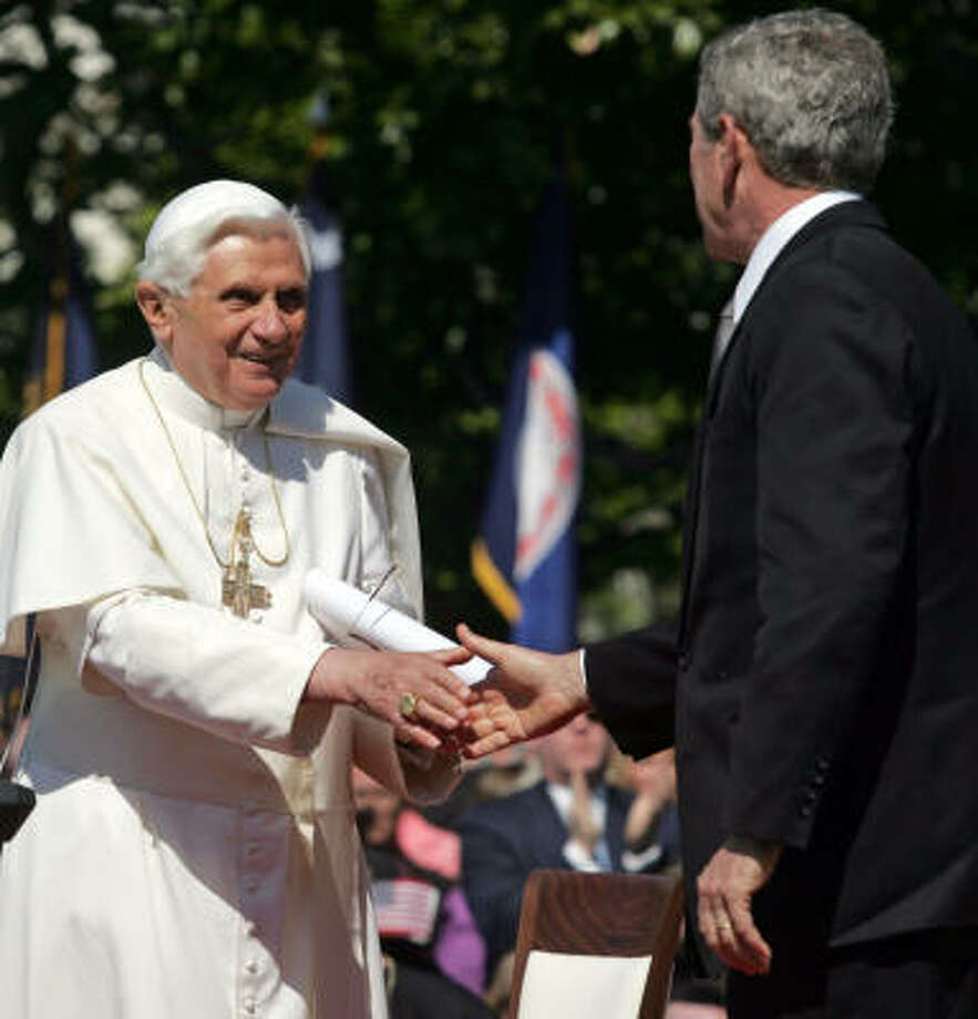 US President George W. Bush shakes hands with Pope Benedict XVI on the South Lawn of the White House on Wednesday. Benedict XVI became just the second pope to visit the White House and the first to come here in nearly three decades. Photo: SAUL LOEB, AFP/Getty Images