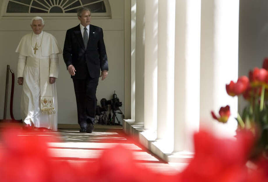 Pope Benedict XVI and US President George W. Bush walk through the colonnade to the Oval Office of the White House on Wednesday. Photo: JIM WATSON, AFP/Getty Images