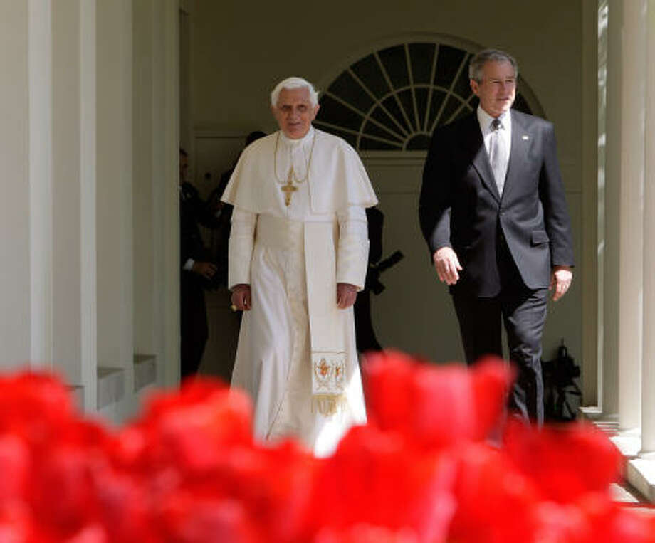 President Bush and Pope Benedict XVI walk to the Oval Office of the White House in Washington on Wednesday following an arrival ceremony on the South Lawn. Photo: Ron Edmonds, AP