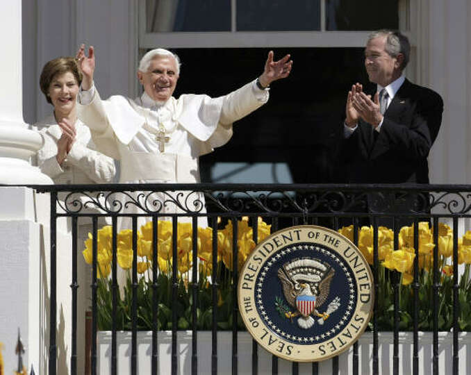 President Bush and first lady Laura Bush flank Pope Benedict XVI as he waves to the crowd from the b
