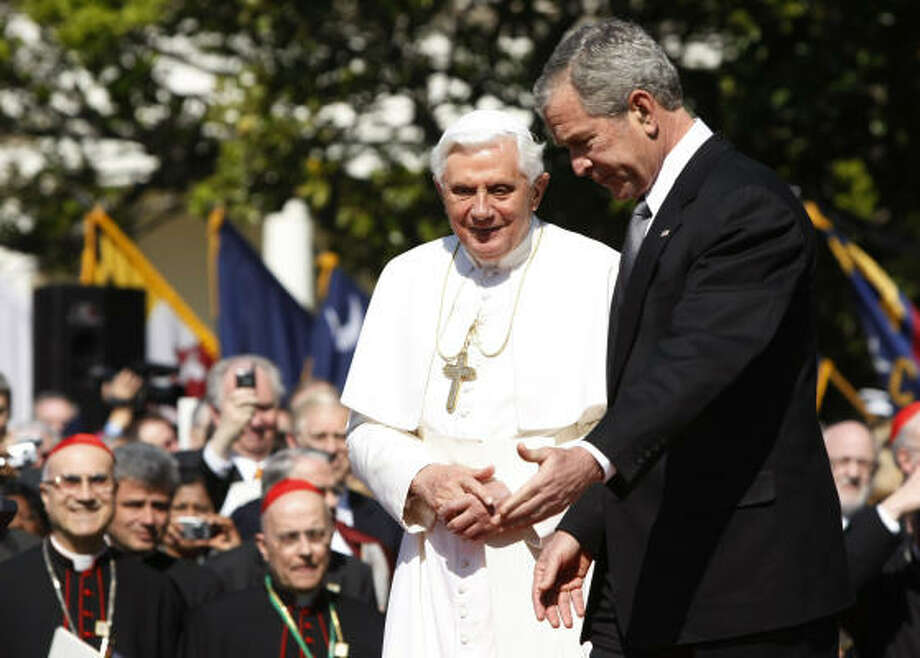 Pope Benedict XVI (L) walks with U.S. President George W. Bush during an arrival ceremony on the South Lawn at the White House on Wednesday. The Pope, who is celebrating his 81st birthday today, is on a six day visit to the U.S., he is scheduled to be in New York City on Friday. Photo: Pool, Getty Images