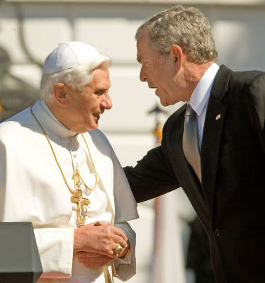 "Pope Benedict XVI listens to US President George W. Bush during a South Lawn Arrival Ceremony on Wednesday. The pope urged President George W. Bush to use ""patient diplomacy to resolve conflicts,"" but did not mention the Iraq war to which the Vatican is strongly opposed. Photo: PAUL J. RICHARDS, AFP/Getty Images"