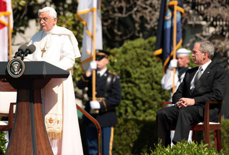U.S. President George W. Bush (right) listens as Pope Benedict XVI speaks during a welcome cermony o