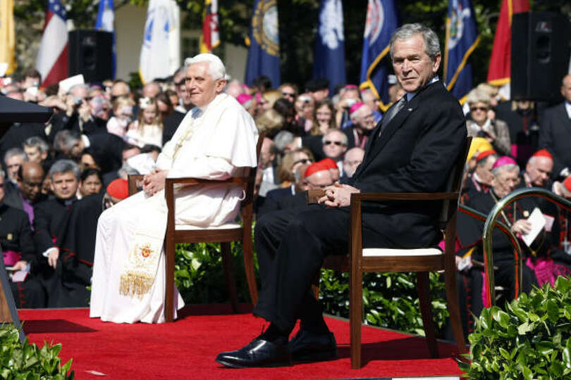 Pope Benedict XVI sits with U.S. President George W. Bush during an arrival ceremony on the South La
