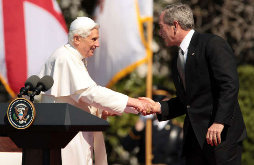 Pope Benedict XVI and U.S. President George W. Bush shake hands during a welcome ceremony on the Sou