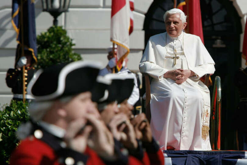 Pope Benedict XVI watches as Fife and Drum Corps perform during an arrival ceremony with U.S. Presid