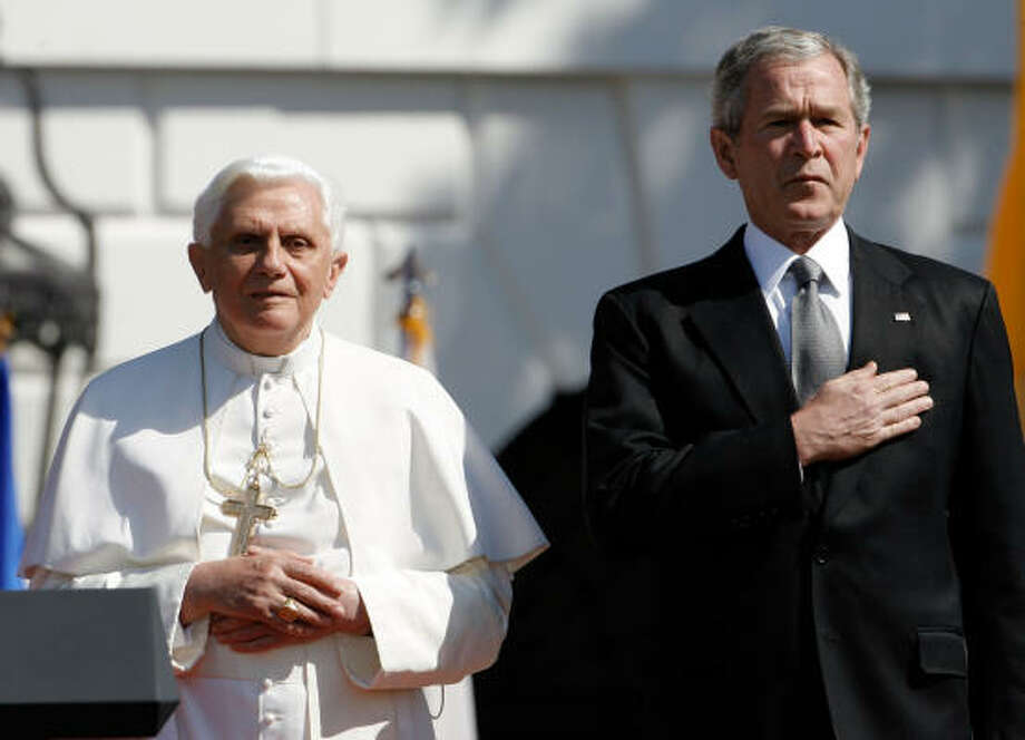 Pope Benedict XVI and U.S. President George W. Bush listen to the national anthem of the United States during an arrival ceremony on the south lawn of the White House on Wednesday. Today is the second day of the Pope's visit to the United States he is scheduled to be in New York City on Friday. Photo: Chip Somodevilla, Getty Images