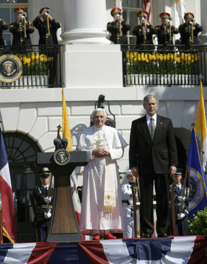 President Bush and Pope Benedict XVI stand on the South Lawn of the White House in Washington on during an arrival ceremony for the Pope. Photo: Pablo Martinez Monsivais, AP