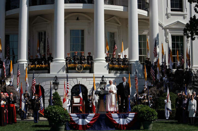 Pope Benedict XVI and U.S. President George W. Bush listen to the national anthem of the Vatican dur