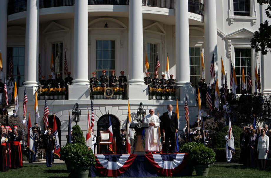Pope Benedict XVI and U.S. President George W. Bush listen to the national anthem of the Vatican during an arrival ceremony on the south lawn of the White House on Wednesday. Photo: Chip Somodevilla, Getty Images