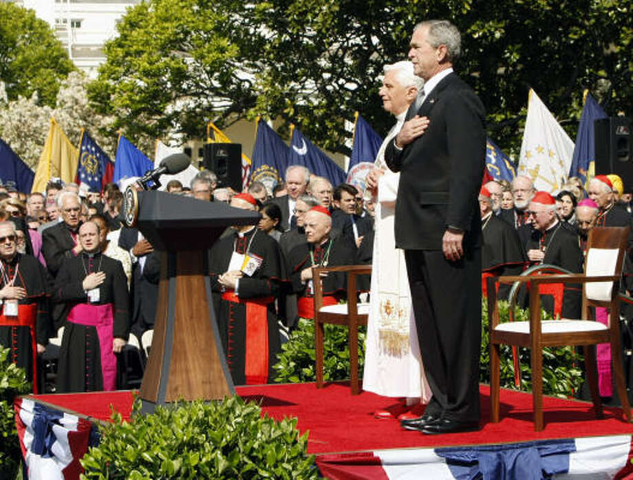President Bush and Pope Benedict XVI listen to the National Anthem on Wednesday during a South Lawn arrival ceremony at the White House in Washington. Photo: Gerald Herbert, AP
