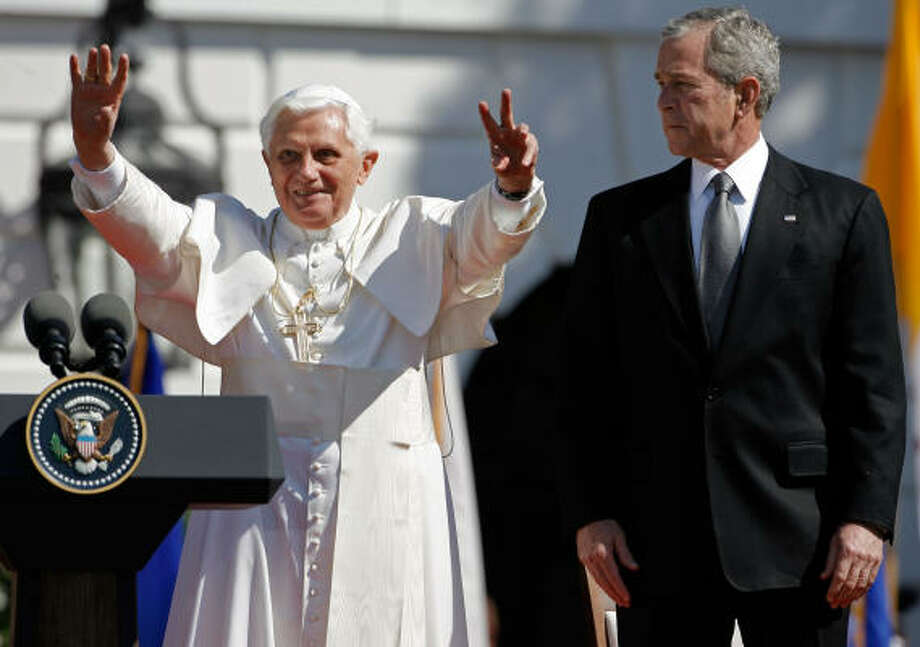 Pope Benedict XVI (L) waves to the crowd on Wednesday as he joins with U.S. President George W. Bush in an arrival ceremony on the South Lawn at the White House in Washington, DC. Today is the second day of the Pope's visit to the United States he is scheduled to be in New York City on Friday. Photo: Chip Somodevilla, Getty Images