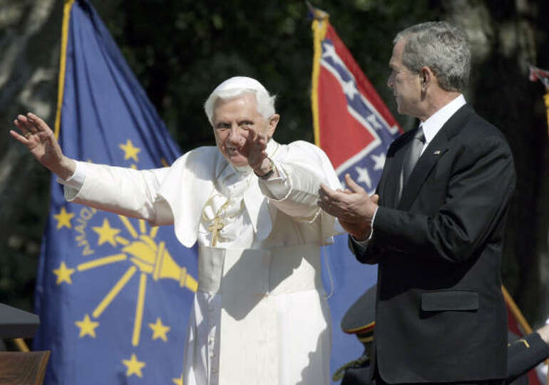 Pope Benedict XVI waves to the crowd as President Bush applauds on Wednesday during a South Lawn arr