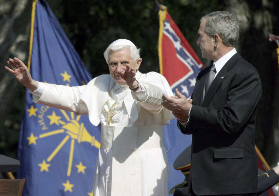 Pope Benedict XVI waves to the crowd as President Bush applauds on Wednesday during a South Lawn arrival ceremony at the White House in Washington. Photo: Ron Edmonds, AP